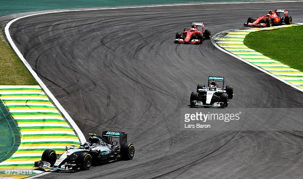 Nico Rosberg of Germany and Mercedes GP Lewis Hamilton of Great Britain and Mercedes GP Sebastian Vettel of Germany and Ferrari and Kimi Raikkonen of...