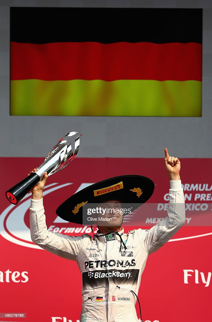 <a gi-track='captionPersonalityLinkClicked' href=/galleries/search?phrase=Nico+Rosberg&family=editorial&specificpeople=800808 ng-click='$event.stopPropagation()'>Nico Rosberg</a> of Germany and Mercedes GP lifts the trophy as he celebrates on the podium after winning the Formula One Grand Prix of Mexico at Autodromo Hermanos Rodriguez on November 1, 2015 in Mexico City, Mexico.