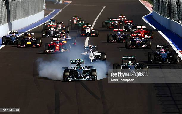 Nico Rosberg of Germany and Mercedes GP locks up approaching turn two next to Lewis Hamilton of Great Britain and Mercedes GP during the Russian...