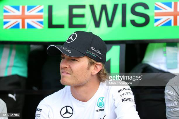 Nico Rosberg of Germany and Mercedes GP looks on during the team celebration following Lewis Hamilton of Great Britain and Mercedes GP's victory in...
