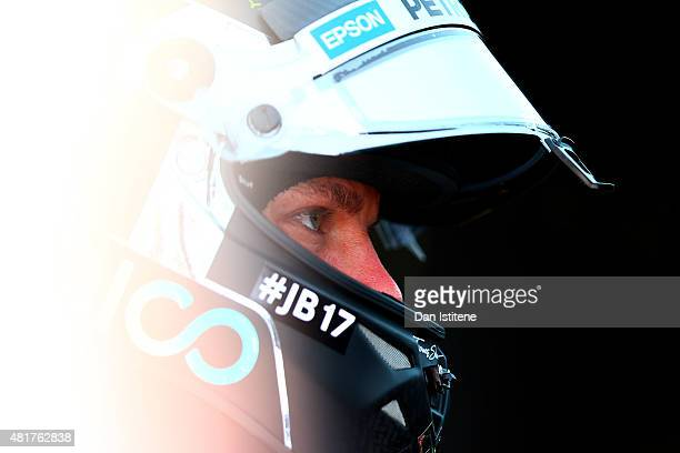 Nico Rosberg of Germany and Mercedes GP looks on in the garage during practice for the Formula One Grand Prix of Hungary at Hungaroring on July 24...