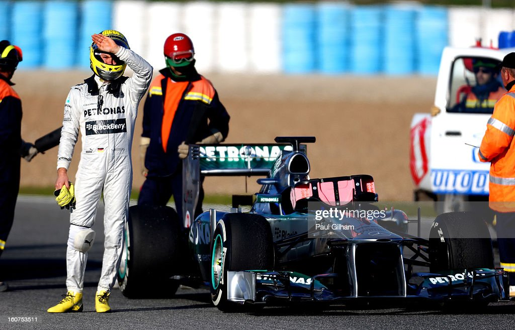 Nico Rosberg of Germany and Mercedes GP reacts after climbing out of his W04 after flames erupted from the rear of the car during Formula One winter testing at Circuito de Jerez on February 5, 2013 in Jerez de la Frontera, Spain.