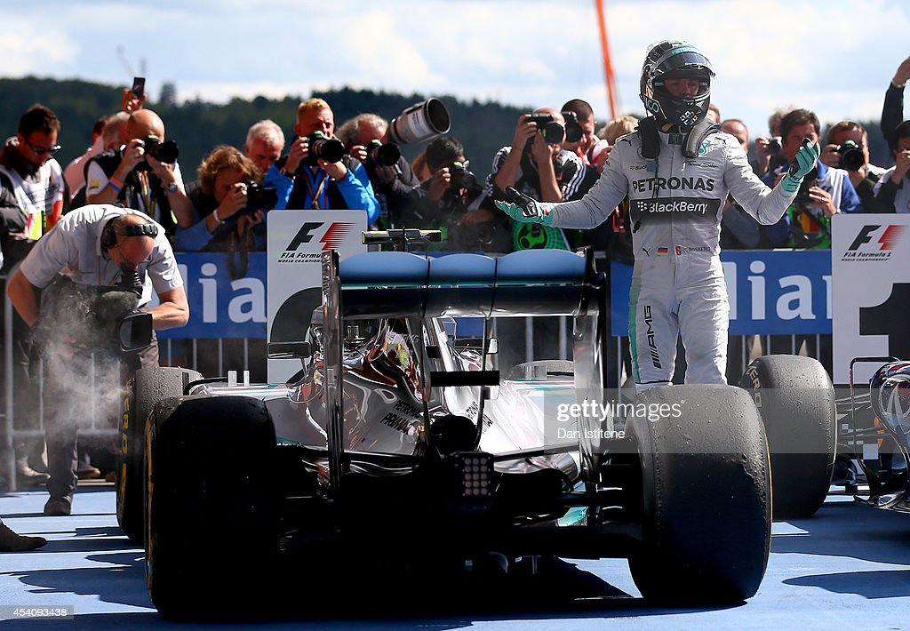 Nico Rosberg of Germany and Mercedes GP reacts as he gets out of his car in Parc Ferme after finishing second in the Belgian Grand Prix at Circuit de Spa-Francorchamps on August 24, 2014 in Spa, Belgium.