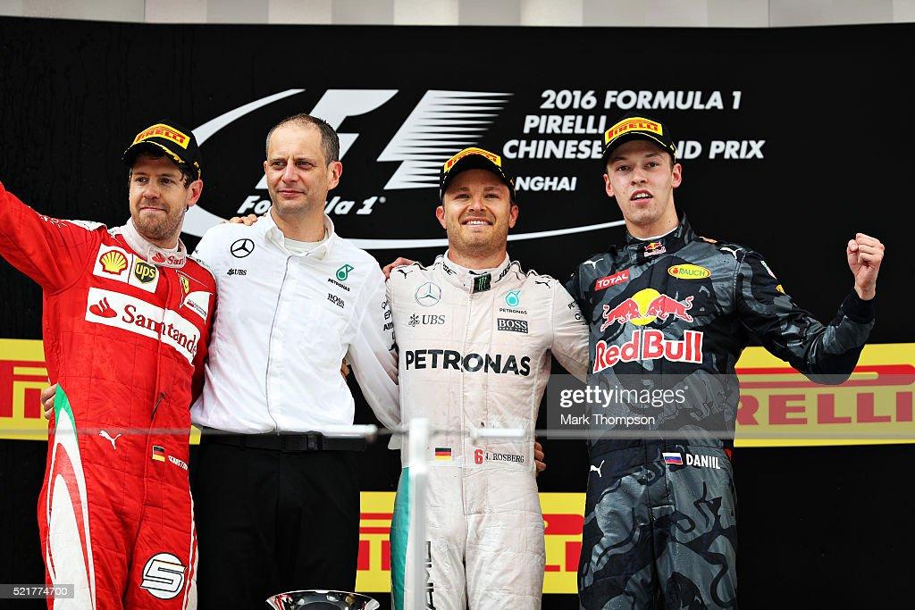 Nico Rosberg of Germany and Mercedes GP Sebastian Vettel of Germany and Ferrari and Daniil Kvyat of Russia and Red Bull Racing celebrate on the...