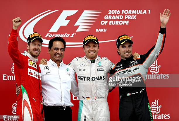Nico Rosberg of Germany and Mercedes GP Sebastian Vettel of Germany and Ferrari and Sergio Perez of Mexico and Force India celebrate on the podium...