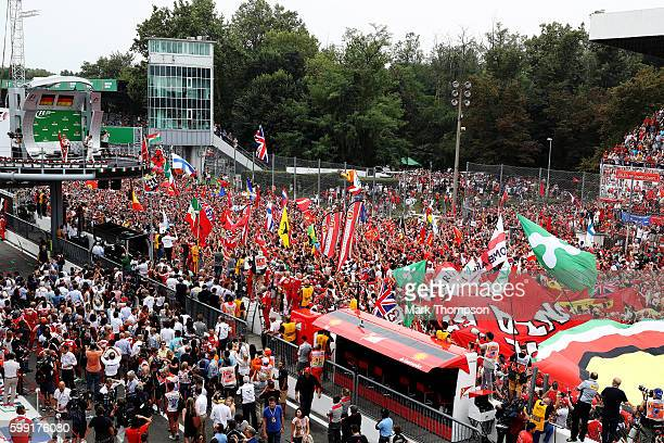 Nico Rosberg of Germany and Mercedes GP Sebastian Vettel of Germany and Ferrari celebrate on the podium during the Formula One Grand Prix of Italy at...