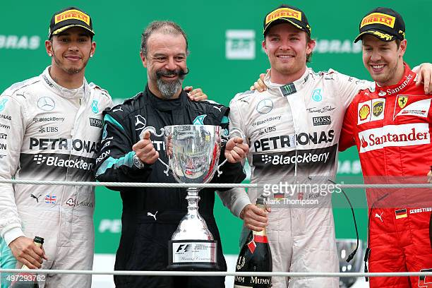 Nico Rosberg of Germany and Mercedes GP stands with Lewis Hamilton of Great Britain and Mercedes GP and Sebastian Vettel of Germany and Ferrari on...