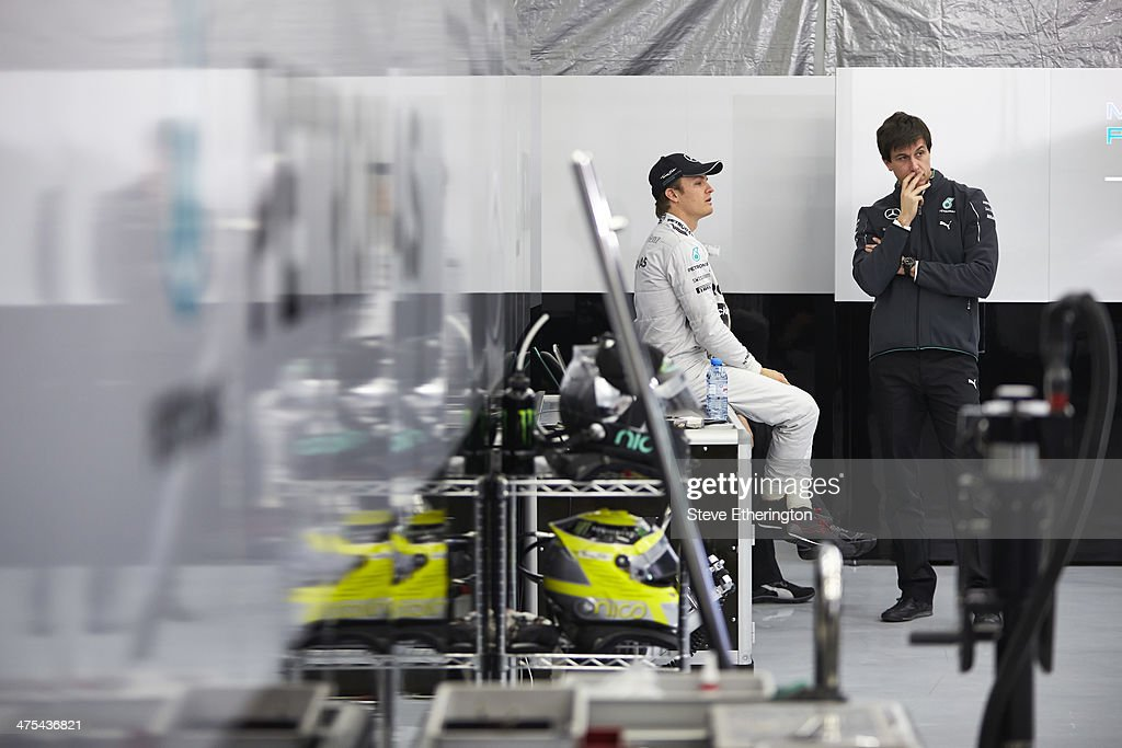 <a gi-track='captionPersonalityLinkClicked' href=/galleries/search?phrase=Nico+Rosberg&family=editorial&specificpeople=800808 ng-click='$event.stopPropagation()'>Nico Rosberg</a> of Germany and Mercedes GP talks with Toto Wolff as he prepares to drive during Formula One Winter Testing at the Circuito de Jerez on January 29, 2014 in Jerez de la Frontera, Spain.