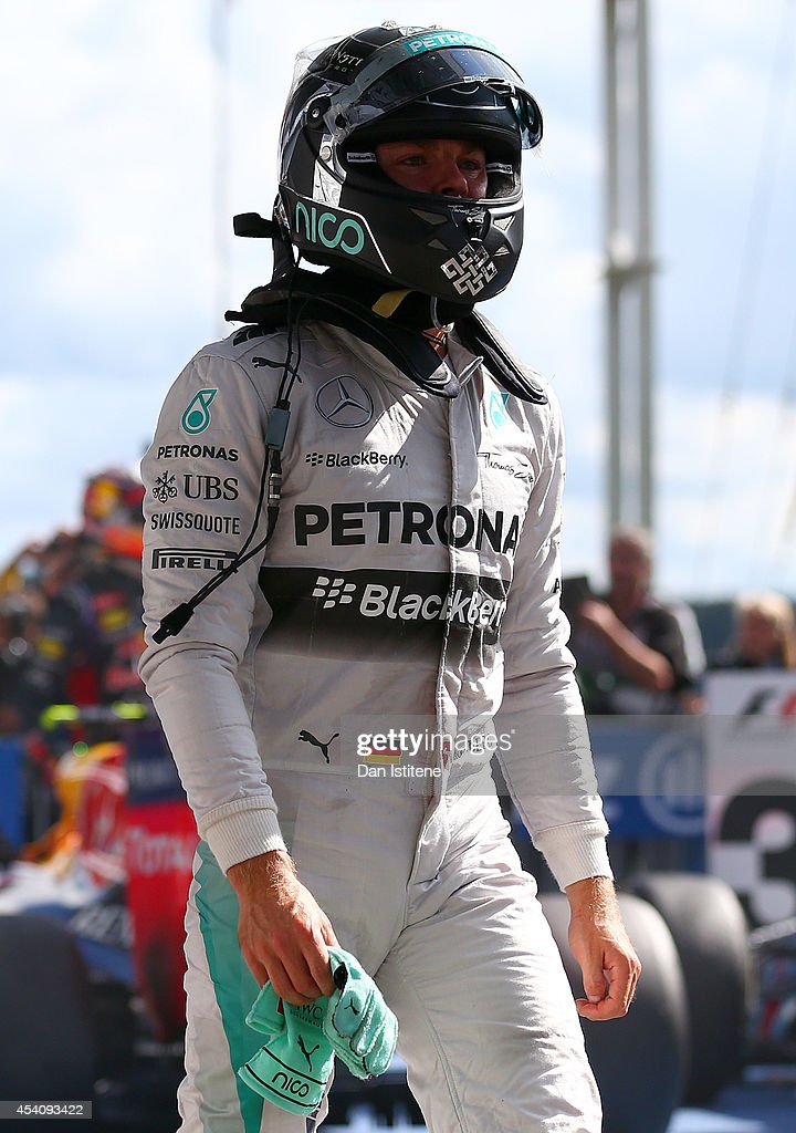 Nico Rosberg of Germany and Mercedes GP walks up to the podium after arriving in Parc Ferme during the Belgian Grand Prix at Circuit de Spa-Francorchamps on August 24, 2014 in Spa, Belgium.