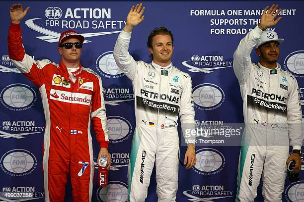 Nico Rosberg of Germany and Mercedes GP waves to crowd next to Lewis Hamilton of Great Britain and Mercedes GP and Kimi Raikkonen of Finland and...