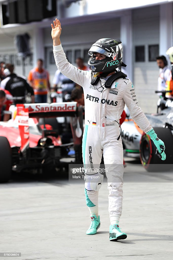 Nico Rosberg of Germany and Mercedes GP waves to the crowd after qualifying in pole position during qualifying for the Formula One Grand Prix of...
