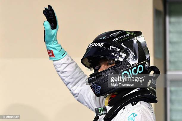 Nico Rosberg of Germany and Mercedes GP waves to the crowd after qualifying in 2nd position on the grid during qualifying for the Abu Dhabi Formula...