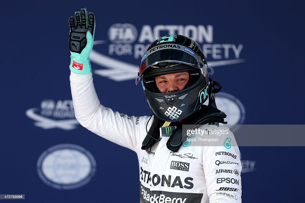 <a gi-track='captionPersonalityLinkClicked' href=/galleries/search?phrase=Nico+Rosberg&family=editorial&specificpeople=800808 ng-click='$event.stopPropagation()'>Nico Rosberg</a> of Germany and Mercedes GP waves to the crowd after claiming pole position during qualifying for the Spanish Formula One Grand Prix at Circuit de Catalunya on May 9, 2015 in Montmelo, Spain.