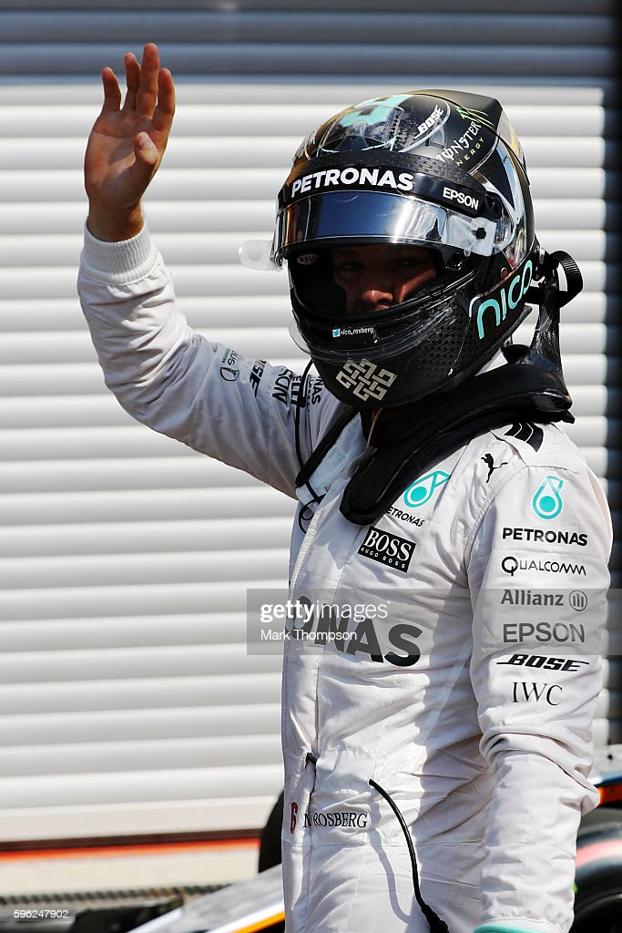Nico Rosberg of Germany and Mercedes GP waves to the crowd from parc ferme after qualifying on pole position during qualifying for the Formula One...