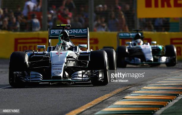 Nico Rosberg of Germany and Mercedes GP waves to the crowd in front of Lewis Hamilton of Great Britain and Mercedes GP after the Australian Formula...