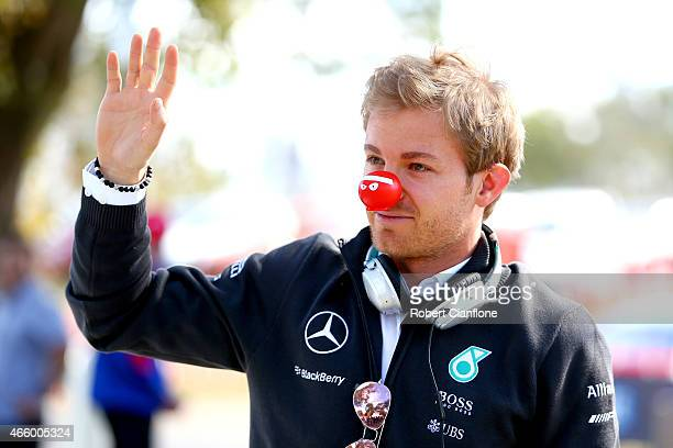 Nico Rosberg of Germany and Mercedes GP wears a red nose for Red Nose Day as he arrives for practice for the Australian Formula One Grand Prix at...
