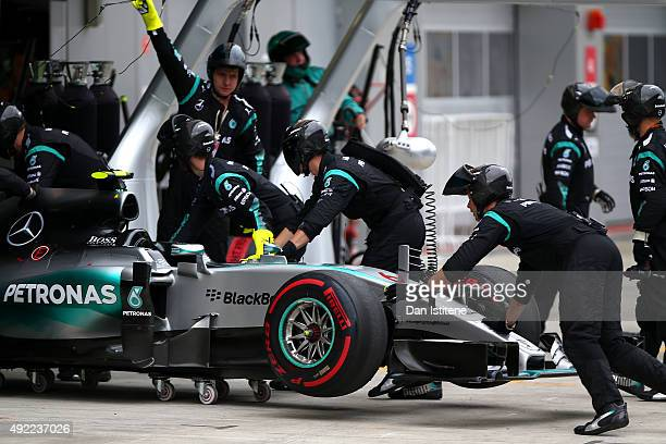 Nico Rosberg of Germany and Mercedes GP's car is pushed back into the garage after he retired from the Formula One Grand Prix of Russia at Sochi...