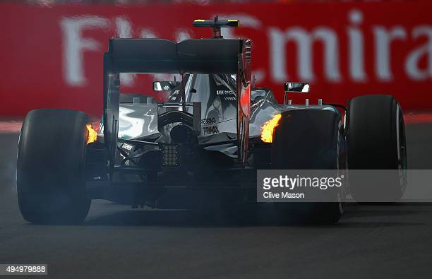 Nico Rosberg of Germany and Mercedes GP's rear brakes catch fire as he drives during practice for the Formula One Grand Prix of Mexico at Autodromo...