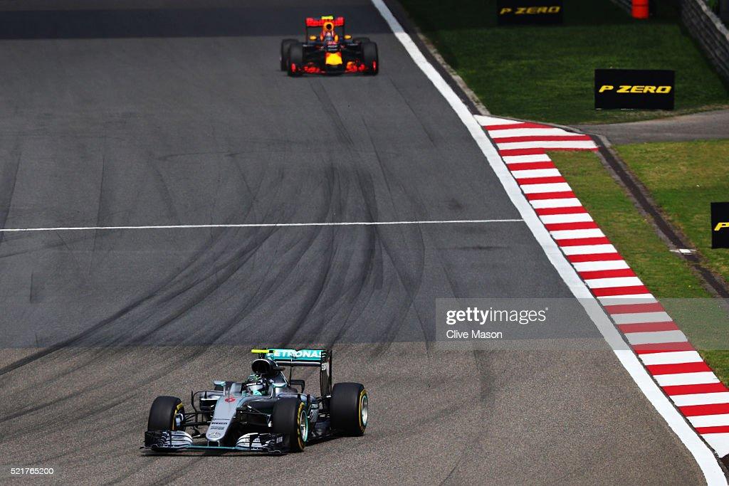 Nico Rosberg of Germany driving the Mercedes AMG Petronas F1 Team Mercedes F1 WO7 Mercedes PU106C Hybrid turbo leads Daniil Kvyat of Russia driving...