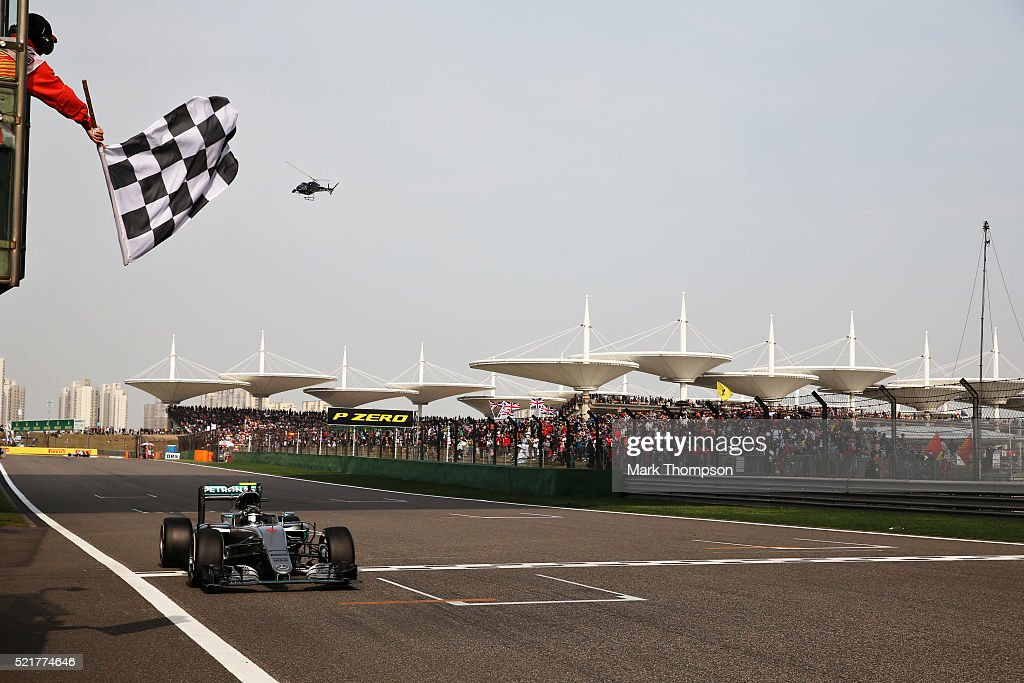 Nico Rosberg of Germany driving the Mercedes AMG Petronas F1 Team Mercedes F1 WO7 Mercedes PU106C Hybrid turbo crosses the line to take the win...