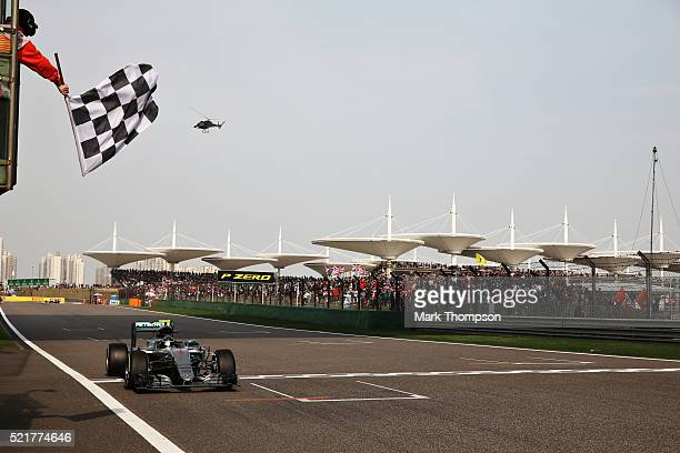 Nico Rosberg of Germany driving the Mercedes AMG Petronas F1 Team Mercedes F1 WO7 Mercedes PU106C Hybrid turbo crosses the line to take the win...