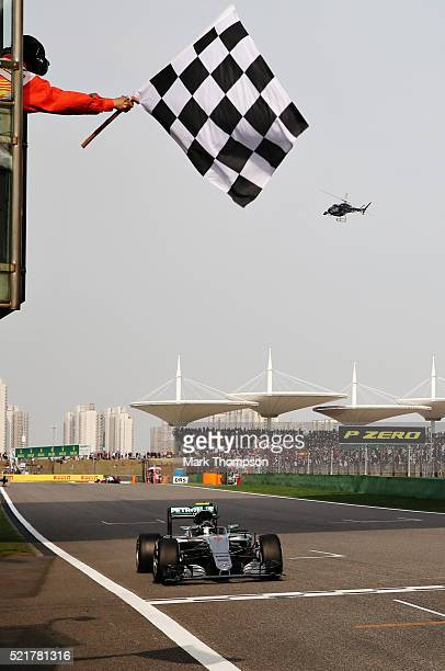 Nico Rosberg of Germany driving the Mercedes AMG Petronas F1 Team Mercedes F1 WO7 Mercedes PU106C Hybrid turbo crosses the line to take the chequered...