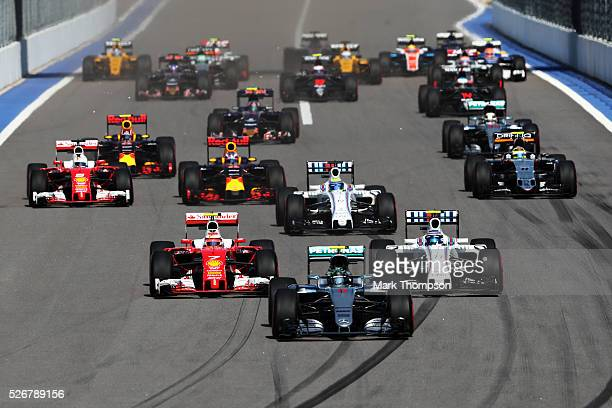Nico Rosberg of Germany driving the Mercedes AMG Petronas F1 Team Mercedes F1 WO7 Mercedes PU106C Hybrid turbo leads at the start from Kimi Raikkonen...