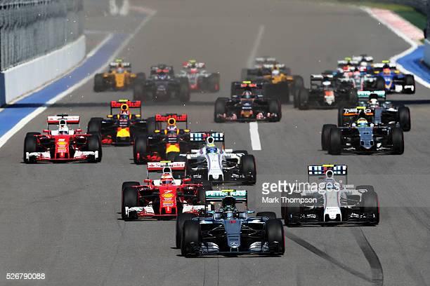 Nico Rosberg of Germany driving the Mercedes AMG Petronas F1 Team Mercedes F1 WO7 Mercedes PU106C Hybrid turbo leads at the start ahead of Kimi...