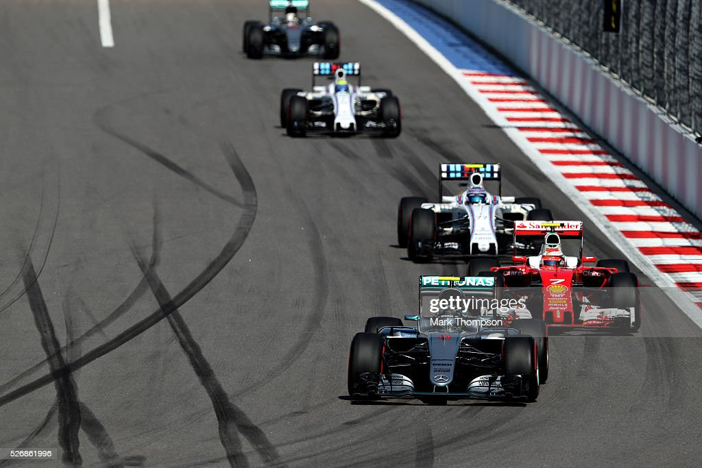 <a gi-track='captionPersonalityLinkClicked' href=/galleries/search?phrase=Nico+Rosberg&family=editorial&specificpeople=800808 ng-click='$event.stopPropagation()'>Nico Rosberg</a> of Germany driving the (6) Mercedes AMG Petronas F1 Team Mercedes F1 WO7 Mercedes PU106C Hybrid turbo leads <a gi-track='captionPersonalityLinkClicked' href=/galleries/search?phrase=Kimi+Raikkonen&family=editorial&specificpeople=201904 ng-click='$event.stopPropagation()'>Kimi Raikkonen</a> of Finland driving the (7) Scuderia Ferrari SF16-H Ferrari 059/5 turbo (Shell GP), and <a gi-track='captionPersonalityLinkClicked' href=/galleries/search?phrase=Valtteri+Bottas&family=editorial&specificpeople=8640136 ng-click='$event.stopPropagation()'>Valtteri Bottas</a> of Finland driving the (77) Williams Martini Racing Williams FW38 Mercedes PU106C Hybrid turbo on track during the Formula One Grand Prix of Russia at Sochi Autodrom on May 1, 2016 in Sochi, Russia.