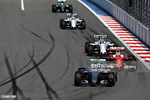 Nico Rosberg of Germany driving the Mercedes AMG Petronas F1 Team Mercedes F1 WO7 Mercedes PU106C Hybrid turbo leads Kimi Raikkonen of Finland...