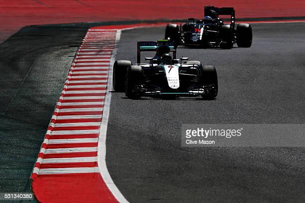 Nico Rosberg of Germany driving the Mercedes AMG Petronas F1 Team Mercedes F1 WO7 Mercedes PU106C Hybrid turbo on track ahead of Fernando Alonso of...