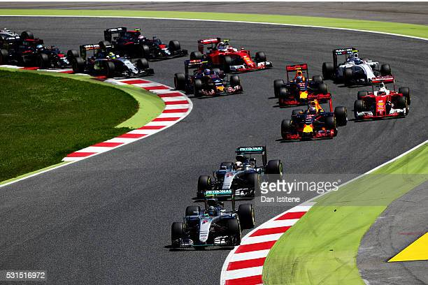Nico Rosberg of Germany driving the Mercedes AMG Petronas F1 Team Mercedes F1 WO7 Mercedes PU106C Hybrid turbo leas Lewis Hamilton of Great Britain...