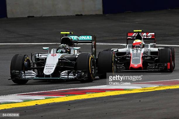 Nico Rosberg of Germany driving the Mercedes AMG Petronas F1 Team Mercedes F1 WO7 Mercedes PU106C Hybrid turbo leads Esteban Gutierrez of Mexico...