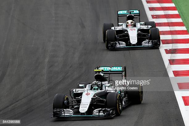 Nico Rosberg of Germany driving the Mercedes AMG Petronas F1 Team Mercedes F1 WO7 Mercedes PU106C Hybrid turbo leads Lewis Hamilton of Great Britain...