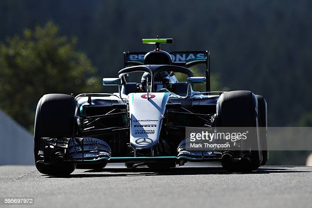 Nico Rosberg of Germany driving the Mercedes AMG Petronas F1 Team Mercedes F1 WO7 Mercedes PU106C Hybrid turbo fitted with the halo on track during...