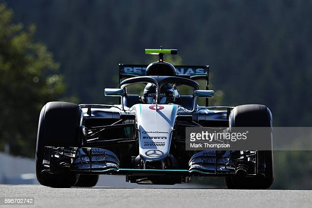 Nico Rosberg of Germany driving the Mercedes AMG Petronas F1 Team Mercedes F1 WO7 Mercedes PU106C Hybrid turbo with the halo fitted on track during...
