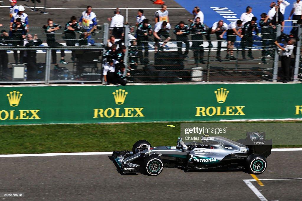 Nico Rosberg of Germany driving the Mercedes AMG Petronas F1 Team Mercedes F1 WO7 Mercedes PU106C Hybrid turbo celebrates as he passes his team...