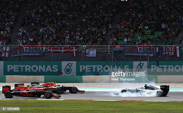 Nico Rosberg of Germany driving the Mercedes AMG Petronas F1 Team Mercedes F1 WO7 Mercedes PU106C Hybrid turbo spins in front of Daniel Ricciardo of...