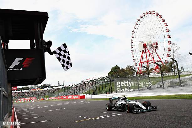 Nico Rosberg of Germany driving the Mercedes AMG Petronas F1 Team Mercedes F1 WO7 Mercedes PU106C Hybrid turbo crosses the line to take te chequered...