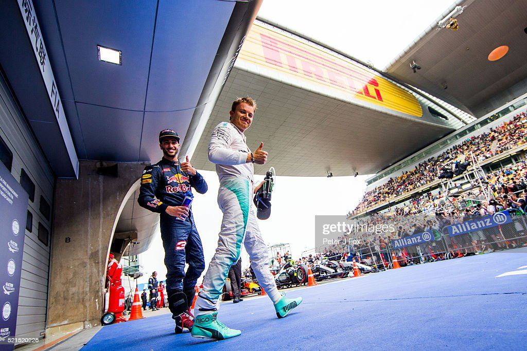 Nico Rosberg of Mercedes and Germany celebrates Pole Position whilst Daniel Ricciardo of Red Bull Racing and Australia celebrates 2nd Place during...