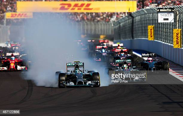 Nico Rosberg of Mercedes and Germany locks up at the start of the Russian Formula One Grand Prix at Sochi Autodrom on October 12 2014 in Sochi Russia