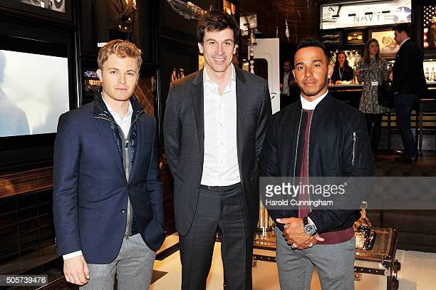 Nico Rosberg Toto Wolff and Lewis Hamilton visit the IWC booth during the launch of the Pilot's Watches Novelties from the Swiss luxury watch...
