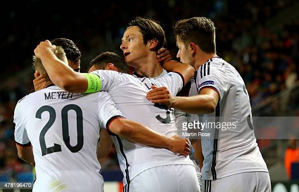 Nico Schluz of Germany celebrate with his team mates after scoring the opening goal during the UEFA European Under21 Group A match between Germany...