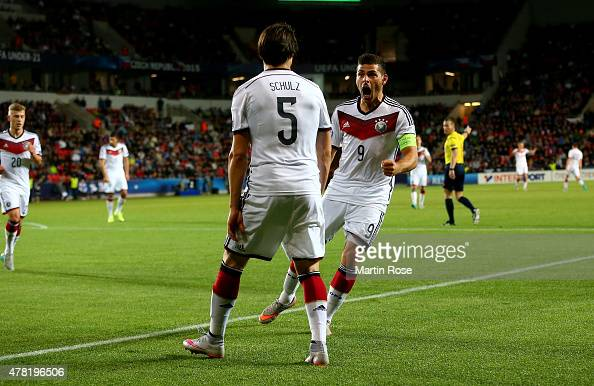 Nico Schluz of Germany celebrate with team mate Kevin Volland after scoring the opening goal during the UEFA European Under21 Group A match between...