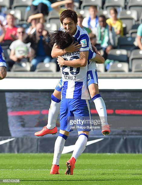 Nico Schulz and Genki Haraguchi of Hertha BSC celebrate after scoring the 20 during the Bundesliga match between Hertha BSC and Werder Bremen on...