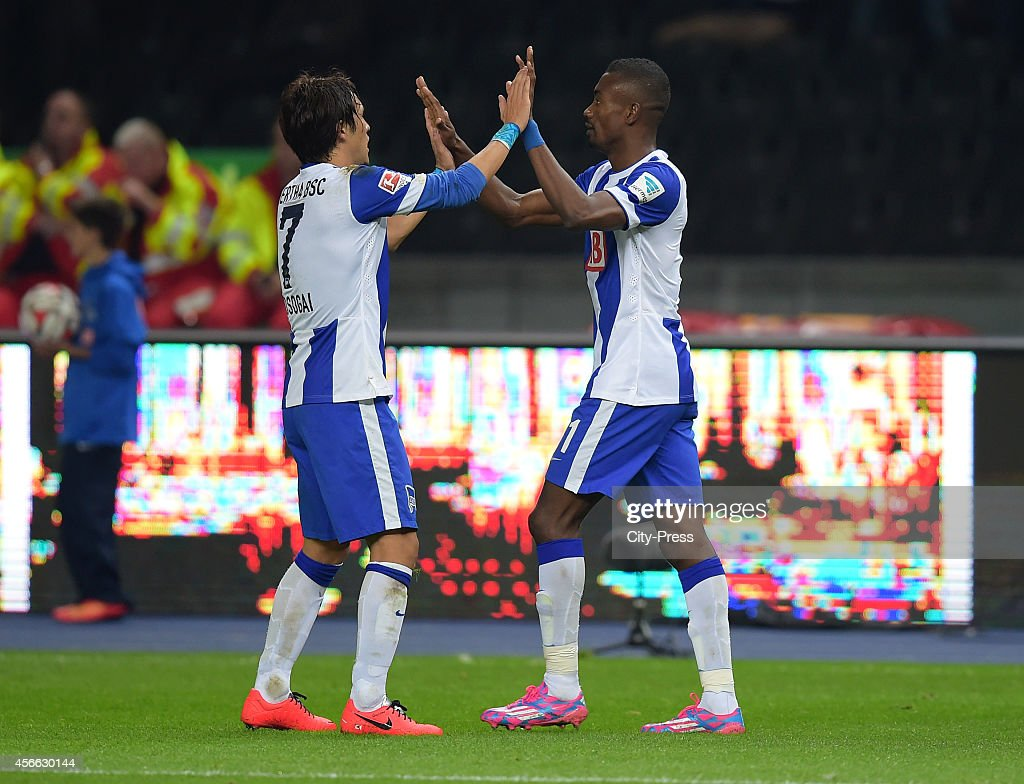 Nico Schulz and <a gi-track='captionPersonalityLinkClicked' href=/galleries/search?phrase=Salomon+Kalou&family=editorial&specificpeople=453312 ng-click='$event.stopPropagation()'>Salomon Kalou</a> of Hertha BSC celebrate after scoring the 2:1 during the Bundesliga match between Hertha BSC and VfB Stuttgart on October 3, 2014 in Berlin, Germany.