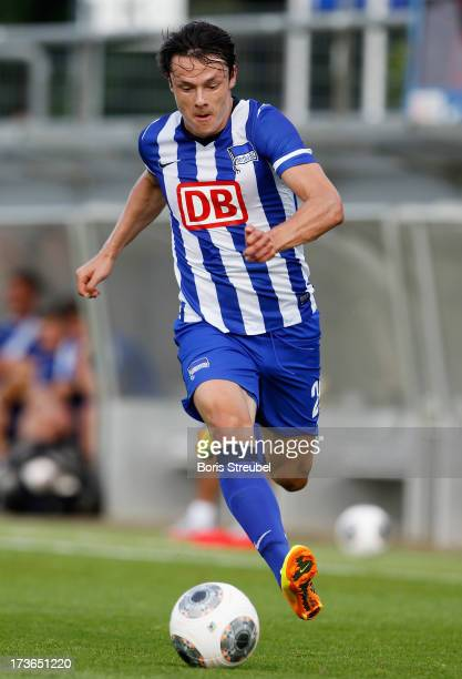 Nico Schulz of Berlin runs with the ball during the friendly match between Hertha BSC and Wisla Krakow at Stadion am Wurfplatz on July 16 2013 in...
