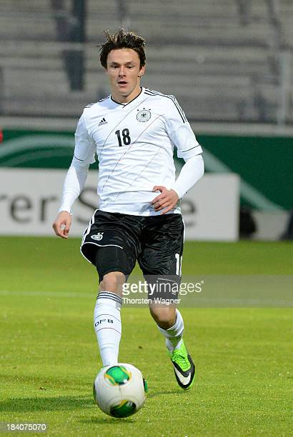 Nico Schulz of Germany runs with the ball during the U21 Euro qualifier group 6 match between Germany and Republic of Montenegro at Brita Arena on...
