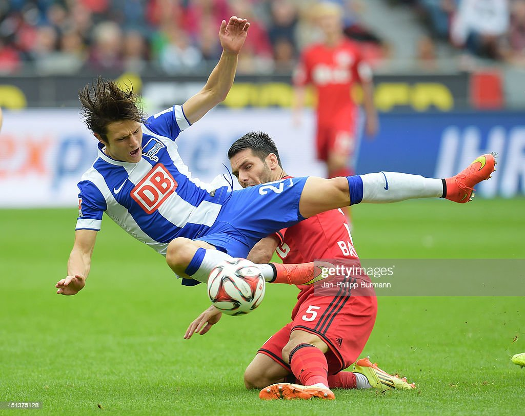 <a gi-track='captionPersonalityLinkClicked' href=/galleries/search?phrase=Nico+Schulz&family=editorial&specificpeople=5385067 ng-click='$event.stopPropagation()'>Nico Schulz</a> of Hertha BSC and Emir Spahic of Bayer 04 Leverkusen compete during the Bundesliga match between Bayer 04 Leverkusen and Hertha BSC at BayArena on August 30, 2014 in Leverkusen, Germany.