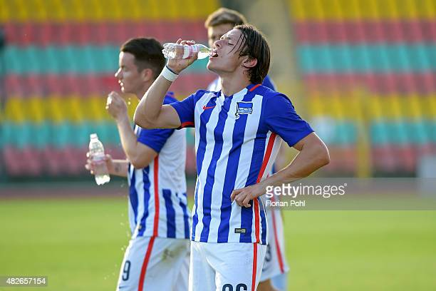 Nico Schulz of Hertha BSC drinks water during the game between Hertha BSC and CFC Genua on august 1 2015 in Berlin Germany